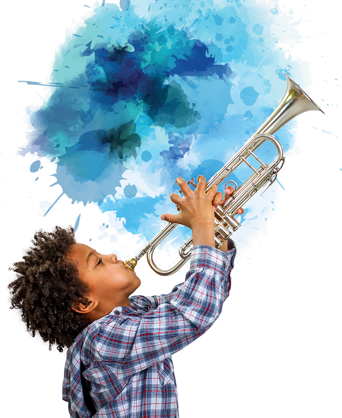 Male child blows playfully on a trumpet