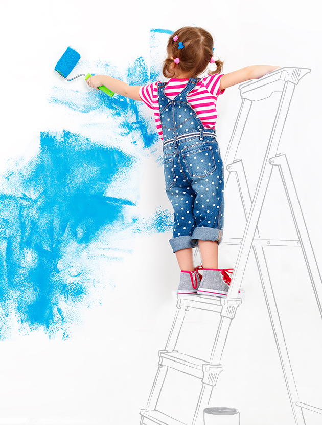 Female child stands on a sketch of a ladder while painting a wall
